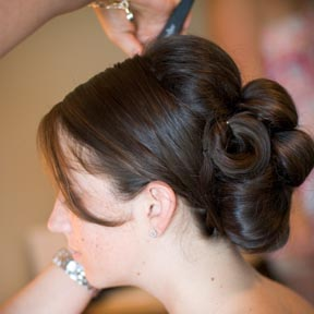 Lather stylist at work creating another bridal look.